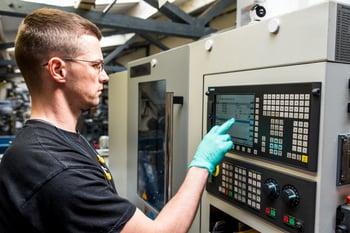 Manufacturing_Employee_Operating_CNC_Machine.jpg