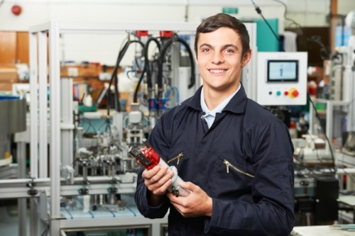 Apprentice Engineer Checking Component in Manufacturing Plant.jpg