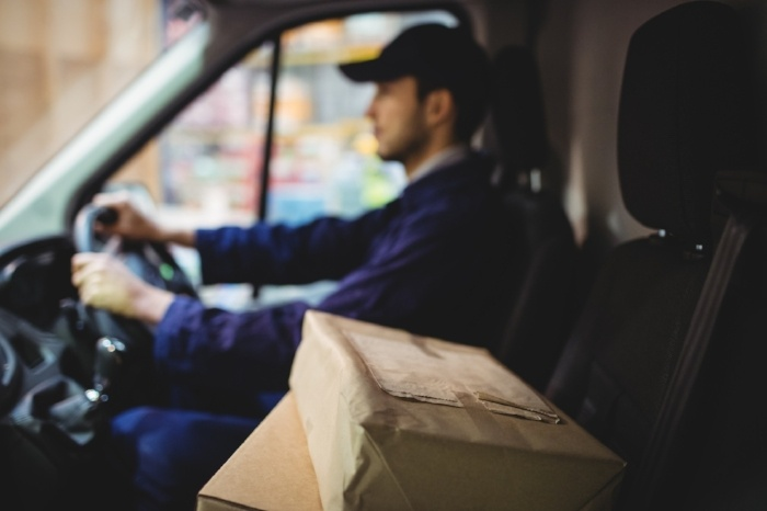 Delivery Driver Driving with Parcels on Seat