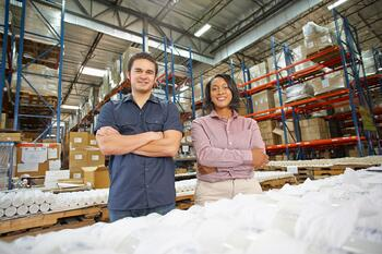 Manager and factory worker improving team leadership and supervisory skills