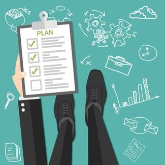 Man Holding ISO Audit Preparation Plan