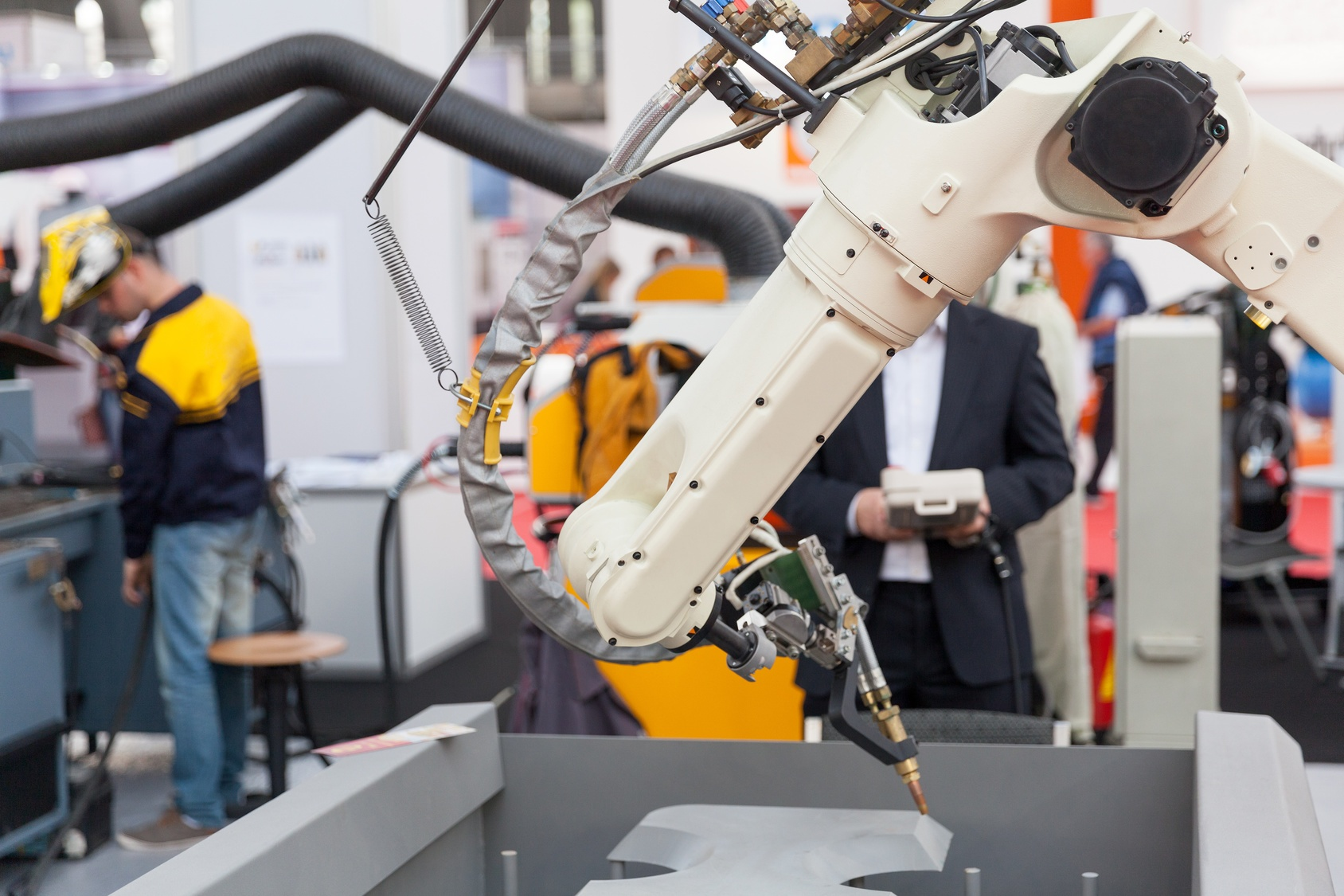 Industrial robot performing automated task in manufacturing facility